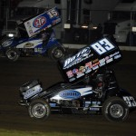 Tim Kaeding (83) and Donny Schatz race for position at 34 Raceway earlier this season. Kaeding held off Schatz to win Tuesday at Willamette Speedway. (Mark Funderburk Photo)