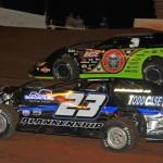 John Blankenship (23) battles Scott Bloomquist during the 2013 Lucas Oil Late Model Dirt Series feature at Tazewell (Tenn.) Speedway. (Michael Moats Photo)