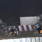 Austin Brown (7), Daniel Robinson (2) and Brandon Waelti (51) all flip as Danny Stratton slips by during Sunday's Badger Midget Series at Wisconsin's Angell Park Speedway. (Bob Cruse Photo)