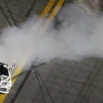 Jimmie Johnson celebrates with a burnout after winning Saturday's Coke Zero 400 at Daytona Int'l Speedway. (HHP/Brian Lawdermilk Photo)