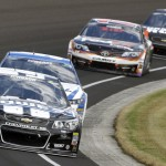 Jimmie Johnson (48) leads a pack of cars during Sunday's Brickyard 400 at Indianapolis Motor Speedway. (HHP/Brian Lawdermilk Photo)