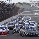 Kyle Busch (54) leads the NASCAR Nationwide Series Indiana 250 during a restart Saturday at Indianapolis Motor Speedway. (HHP/Harold Hinson Photo)