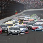 Jimmie Johnson leads the NASCAR Sprint Cup Series field during a restart Sunday at Indianapolis Motor Speedway. (HHP/Harold Hinson Photo)