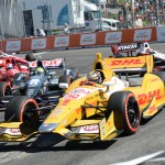 Ryan Hunter-Reay (1) leads a pack of cars during Saturday's IZOD IndyCar Series event at Exhibition Place in Toronto, Ontario. (Al Steinberg Photo)
