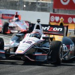 Will Power (12) leads a pack of cars during Sunday's IZOD IndyCar Series race at Exhibition Place in Toronto, Ontario. (Al Steinberg Photo)