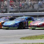 Cars battle three wide during heat race action prior to Sunday's International 500 at Airborne Speedway in New York. (Leif Tillotson Photo)