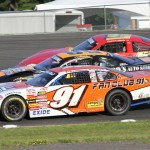 Patrick Laperle (91) moves to the low side of two others car to go three-wide during Sunday's International 500 at Airborne Speedway in New York. (Leif Tillotson Photo)