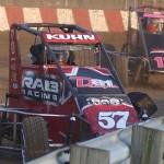 Brad Kuhn (57) wheels his midget through a turn Sunday at Angell Park Speedway in Sun Prairie, Wis. (Roger Hamilton Photo)