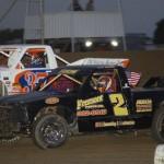 Matt Foos (2) battles Eric Devanna during dirt truck competition at Ohio's Attica Raceway Park. (Action photo)