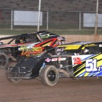 Dustin Jackson (51) and Nick Firari jockey for position during Saturday's modified feature at Wisconsin's Beaver Dam Raceway. (Bob Cruse photo)