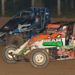 Brady Bacon (69) battles Ryan Pace during Thursday's AMSOIL USAC National Sprint Car Series race at Lincoln Park Speedway in Putnamville, Ind. (Dave Heithaus Photo)