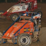 Robert Ballou (12) battles Chad Boespflug during Thursday's AMSOIL USAC National Sprint Car Series event at Lincoln Park Speedway in Putnamville, Ind. (Dave Heithaus Photo)