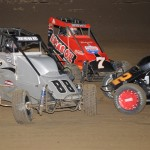 Terry Babb (88), Austin Brown (7) and Seth Motsinger tangle during Friday's Honda USAC National Dirt Midget Series event at Belle-Clair Speedway in Belleville, Ill. (Don Figler Photo)