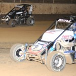 Colten Cottle (5) and Bryan Clauson fight for position during Saturday's Honda USAC National Dirt Midget Series feature at Belle-Clair Speedway in Belleville, Ill. (Don Figler Photo)