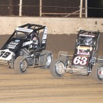 Bryan Clauson (39) and Jerry Coons Jr. battle for the race lead during Saturday's Honda USAC National Dirt Midget Series event at Belle-Clair Speedway in Belleville, Ill. (Don Figler Photo)