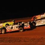 Scott Bloomquist (0), Dale McDowell (17), Darrell Lanigan (29) and Tim McCreadie battle during Saturday's Firecracker 100 at Lernerville Speedway. (Julia Johnson Photo)