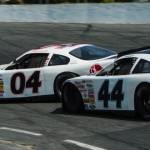 Dillon Bassett (44) makes contact with the No. 04 driven by his brother Ronnie Bassett Jr. while battling for the race lead of Sunday's UARA-STARS Late Model Series event at Caraway Speedway in Asheboro, N.C. (Drew Hierwarter Photo)