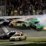 Cars crash at the start finish line as the checkered flag waves at the end of the Coke Zero 400 at Daytona Int'l Speedway. (NASCAR Photo)