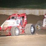 Chad Boespflug (57) and Shane Cottle fight for the lead during Saturday's sprint car feature at Indiana's Lincoln Park Speedway. (LPS photo)
