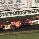 Ted Christopher leads Doug Coby en route to winning the Sk modified feature at Stafford Motor Speedway for his 100th victory at the Connecticut track. (Dick Ayers photo).