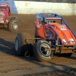 Robert Ballou (12) battles Jon Stabrough during heat race action Wednesday during the AMSOIL USAC National Sprint Car Series at the Terre Haute (Ind.) Action Track. (John DaDalt Photo)