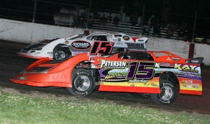 Justin Kay (15k) drives to victory in during a Deery Brother Summer Series late-model event at West Liberty (Iowa) Raceway. (Mike Ruefer Photo)