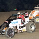 Scott Weir (18s) and Richard Vander Weerd work their way around Indiana's Gas City I-69 Speedway. Weir won the feature. (Gordon Gill photo)