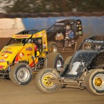 Kurt Gross (1x), Tracy Hines (4) and Dave Darland battle three-wide during Wednesday's AMSOIL USAC National Sprint Car Series event at the Terre Haute (Ind.) Action Track. (Dave Heithaus Photo)