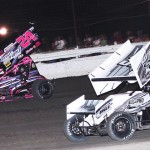 Brandi Jass (24) and Brandon Berryman battle during Saturday's ASCS Gulf South Region event at Battleground Speedway in Houston, Texas. (RonSkinnerPhotos.com Photo)