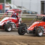 Spencer Bayston races Clayton Gaines during Mel Kenyon Midget Series action Saturday at Indiana's U.S. 24 Speedway. (Gary Gasper photo)