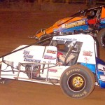 Battling it out for the lead position during the BOSS non-winged sprint car event at Pennsylvania's Lernerville Speedway are Tony Beaber (3t) and eventual winner Jack Sodeman Jr. (Hein Brothers photo)