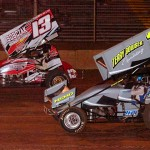 Carl Bowser (10) battles Brandon Matus on his way to winning his first sprint car feature at Pennsylvania's Lernerville Speedway. (Hein Brothers photo)