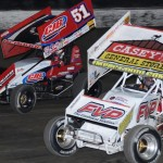 Brian Brown (21) battles alongside Paul McMahan during Friday's World of Outlaws STP Sprint Car Series event at Eldora Speedway. (Julia Johnson Photo)