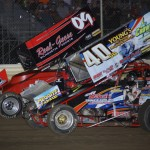 Eventual winner Craig Mintz (09) leads Caleb Griffith during sprint car action at Ohio's Attica Raceway Park. (Action photo)