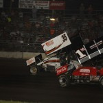 Jim Moughan and Jimmy Hurley (35) fight for position during sprint car competition at Lincoln (Ill.) Speedway. (Mark Funderburk photo)