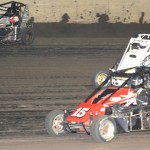 Terry Babb (88) takes the high road to pass Daniel Adler (15) and Danny Frye during Thursday's Lucas Oil POWRi National Midget Series event at Tri-City Speedway in Pontoon Beach, Ill. (Don Figler Photo)