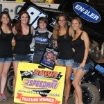 Cale Thomas stands in victory lane after winning Friday's National Speed Sport News 66 Mike Phillips Memorial preliminary event at Belle-Clair Speedway in Belleville, Ill. (Don Figler Photo)