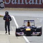 Sebastian Vettel walks away from  his disabled racer during Sunday's British Grand Prix. (Steve Etherington Photo)