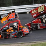 Randy Cabral (47) battles Russ Stoehr during Saturday's Northeastern Midget Ass'n event at Stafford Motor Speedway in Stafford Springs, Conn. (Dick Ayers Photo)