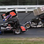 John Zych (9) and Ian Cumens battle during Saturday's Northeastern Midget Ass'n event at Stafford Motor Speedway in Stafford Springs, Conn. (Dick Ayers Photo)