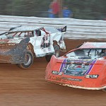 George Dixon (77) and Ralph Morgan Jr. battle for position during the Steel Block Bandits late model race at Path Valley Speedway Park. (Clifford Dove photo)