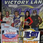 Terry Babb and crew stand in victory lane after winning Thursday's Lucas Oil POWRi National Midget Series feature at Tri-City Speedway. (R.J. Brown Photo)