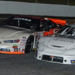 Garrett Campbell races under Travis Swaim (28) as the pair battle for position during the UARA-STARS late model race at North Carolina's Tri-County Motor Speedway. (Drew Hierwarter photo)