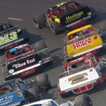 Justin Bonsignore (51) and Eric Goodale (58) lead the NASCAR Whelen Modified Tour field during a restart Saturday at Monadnock Speedway in New Hampshire. (Dick Ayers Photo)