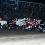 The World of Outlaws Sprint Car Series field salutes the fans by going four-wide prior to Friday's feature at LaSalle (Ill.) Speedway. (Mike Ruefer Photo)