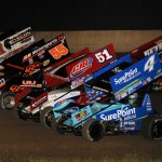The World of Outlaws STP Sprint Car Series field goes four-wide prior to Saturday's feature at Beaver Dam (Wis.) Raceway. (Mark Funderburk Photo)