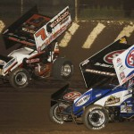 Craig Dollansky (7) battles Donny Schatz during Friday's World of Outlaws STP Sprint Car Series event at LaSalle (Ill.) Speedway. (Mark Funderburk Photo)