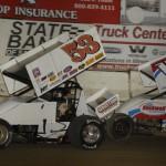 Greg Wilson (53) battles Jerrod Hull during Wednesday's Midwest Open Wheel Ass'n feature at Highland (Ill.) Speedway. (Mark Funderburk Photo)