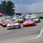 The Grand-Am Rolex Sports Car Series GT field flows into turn one at Watkins Glen (N.Y.) Int'l on Sunday. (Dennis Bicksler Photo)