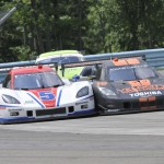 The No. 5 Corvette DP shared by Joao Barbosa & Christian Fittipaldi rubs fenders with the No. 10 Corvette DP driven by Jordan Taylor & Max Angelelli Sunday at Watkins Glen (N.Y.) Int'l. (Dennis Bicksler Photo)